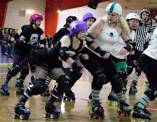 The Gem City Rollergirls take on the Columbus Gang Green at the Orbit Fun Center in Huber Heights, Sunday, March 21, 2010.
