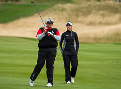 Gleneagles, Scotland, UK; 10 August, 2018.  Day three of European Championships 2018 competition at Gleneagles. Men's and Women's Team Championships Round Robin Group Stage. Four Ball Match Play format.  Pictured; Great Britain;'s Georgia Hall and Laura Davies on  the 2nd hole in match against Belgium.