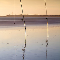 Two fishing rods on the beach. Long exposure shot.