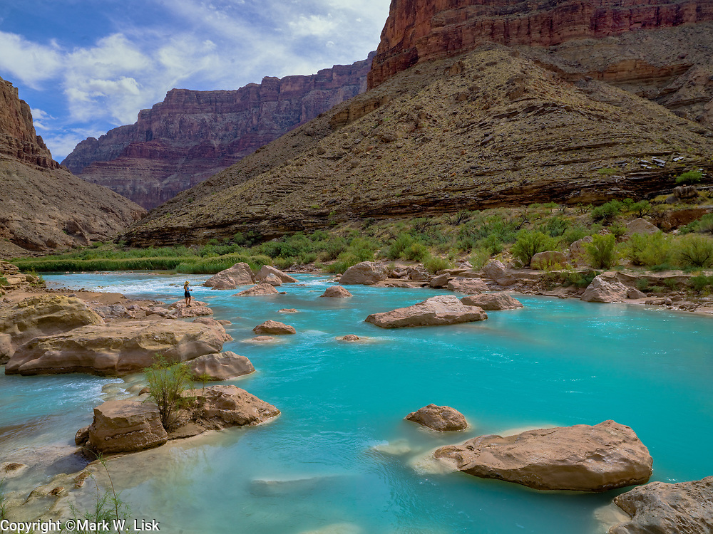 Hikers enjoy the azure color of the Little Colorado near its confluence with the Colorado river in Grand Canyon National Park.