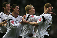 Photo: Pete Lorence.<br />Derby County v Hull City. Coca Cola Championship. 10/02/2007.<br />Gary Teale is congratulated by his team for scoring in the opening goal.