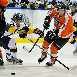 WHITBY, ON - Feb 11: Ontario Junior Hockey League game between Orangeville Flyers and Whitby Fury.  Colin Rigney #7 of the Orangeville Flyers Hockey Club battles for the puck with Carter Landry 22 of the Whitby Fury Hockey Club during second period game action.<br /> (Photo by Shawn Muir / OJHL Images)