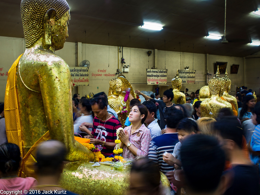 14 JANUARY 2016 - CHACHOENGSAO, CHACHOENGSAO, THAILAND: People pray among  the statues of the Buddha at Wat Sothon. Wat Sothon, in Chachoengsao, is one of the largest Buddhist temples in Thailand. Thousands of people come to the temple every day to pray for good luck, they make merit by donating cooked eggs and cash to the temple. The temple dates from the Ayutthaya period (circa 18th century CE).             PHOTO BY JACK KURTZ