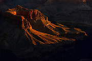 First light painting a throne like mesa in Grand Canyon fine art print for sale or licensed use