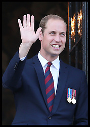 Image licensed to i-Images Picture Agency. 04/08/2014. Mons, Belgium .The Duke of Cambridge waves from the balcony of Mons Town Hall in Belgium during a reception as part of series of events to commemorate  the 100th anniversary of the start of the First World War. Picture by Stephen Lock / i-Images