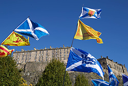 Independence flags flown by marchers in the shadow of Edinburgh Castle pic copyright Terry Murden @edinburghelitemedia