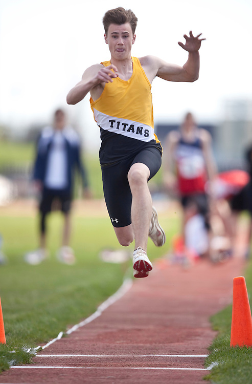 St.Thomas, Ontario ---11-05-07---  Riley Bell of Central Elgin competes in the triple jump at the 2011 Kettle Creek Invitational in St.Thomas, Ontario May 7, 2011. Bell won both the long jump and the triple jump setting new meet records in each in the process.<br /> GEOFF ROBINS/Mundo Sport Images