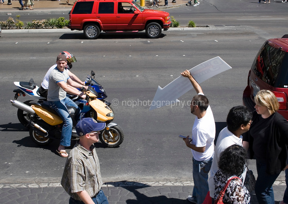 Man promoting a Comedy show on the Las Vegas Boulevard, Las Vegas, Nevada. Also known as The Las Vegas Strip where many of the famous themed casinos and hotels are located.