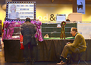 © Licensed to London News Pictures. 24/11/2012. Birmingham, UK Exhibitors wait with their cats cages to be called for judging. Cats are shown by their owners and breeders at The Supreme Cat Show held by the Governing Council of Cat Fancy at the National Exhibition Centre in Birmingham today, 24 November 2012. The Cat Show is one of the largest cat contests in Europe with over one thousand cats being exhibited and judged. Photo credit : Stephen Simpson/LNP