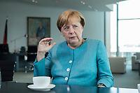 23 AUG 2017, BERLIN/GERMANY:<br /> Angela Merkel, CDU, Bundeskanzlerin, waehrend einem Interview, in Ihrem Buero, Bundeskanzleramt<br /> IMAGE: 20170823-02-001<br /> KEYWORDS: B&uuml;ro