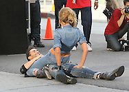 """May 14th 2010. Los Angeles, CA. ***EXCLUSIVE*** Adam Levine and his beautiful Russian Supermodel girlfriend Anne Vyalitsyna filming a Maroon 5 Music Video for their song """"Misery"""". The sexy couple filmed various scenes of loving affection with passionate kissing followed by scenes of humorous violence and destruction. In this action packed Music Video shot on the streets of Downtown Los Angeles, Adam Levine and his band mates are fleeing from Anne Vyalitsyna who is humorously trying to kill them in various ways. Scenes include a missile gun attack and knife throwing from Anne, Adam being hit by a car while running away, Adam being close lined by Anne off a motorcycle that he is fleeing on,  Adam being kicked through a cafe window as well as being ejected from the window of a high rise building. The couple were constantly kissing, hugging and holding hands while on set. They both shared a big luxury trailer while not filming. Photo by Eric Ford/ On Location News. 818-613-3955. info@onlocationnews.com"""