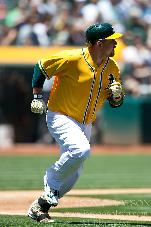 OAKLAND, CA - JUNE 18:  Billy Butler #16 of the Oakland Athletics runs to first base after an at bat against the San Diego Padres during the fourth inning at O.co Coliseum on June 18, 2015 in Oakland, California. The San Diego Padres defeated the Oakland Athletics 3-1. (Photo by Jason O. Watson/Getty Images) *** Local Caption *** Billy Butler