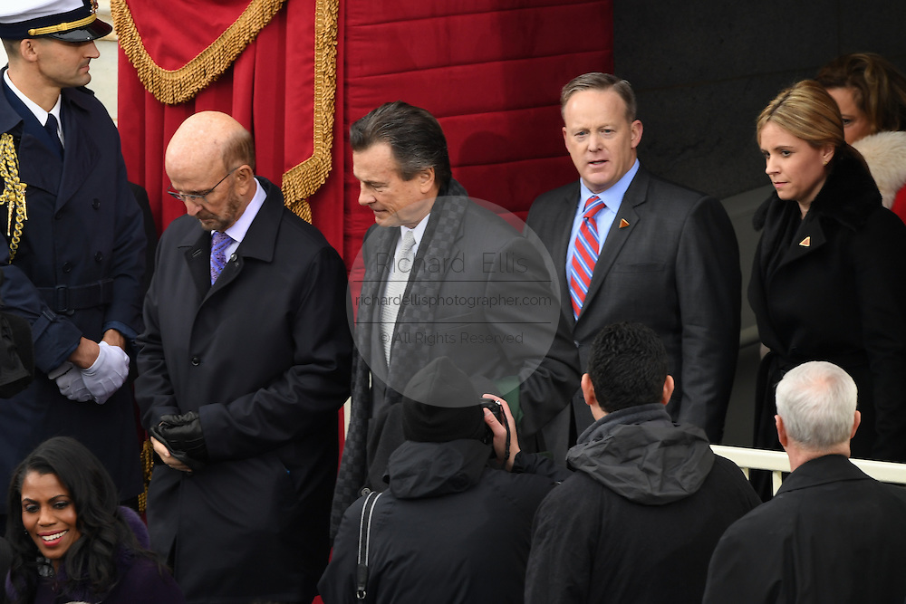 Presidential Press Secretary Sean Spicer, right, arrives for the 68th President Inaugural Ceremony of Donald Trump on Capitol Hill January 20, 2017 in Washington, DC. Left to Right: