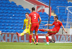 CARDIFF, WALES - Friday, June 5, 2015: Wales' Gareth Bale scores a goal during a practice match at the Cardiff City Stadium ahead of the UEFA Euro 2016 Qualifying Round Group B match against Belgium. (Pic by David Rawcliffe/Propaganda)