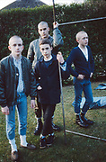Neville, Mark, Lee and Phil stood in garden, High Wycombe, UK, 1980s