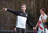 BILTHOVEN - hoofdklasse competitie dames, SCHC-Amsterdam.  coach Rick Mathijssen (A'dam) met Julia Muller. COPYRIGHT KOEN SUYK