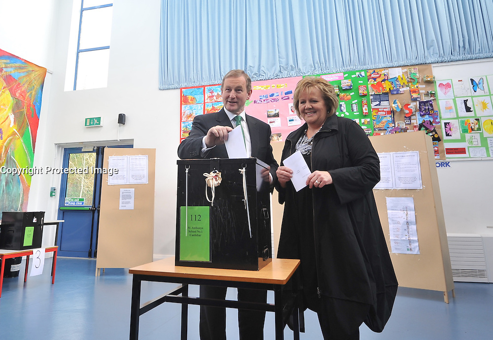 An Taoiseach Enda Kenny with his wife Fionnuala voting in General Election 2016 on friday last at St Anthony's school Castlebar, Co Mayo.   Photo Conor McKeown