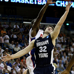 Mar 24, 2011; New Orleans, LA; Brigham Young Cougars guard Jimmer Fredette (32) shoots over Florida Gators forward/center Patric Young (4) during the first half of the semifinals of the southeast regional of the 2011 NCAA men's basketball tournament at New Orleans Arena.  Mandatory Credit: Derick E. Hingle