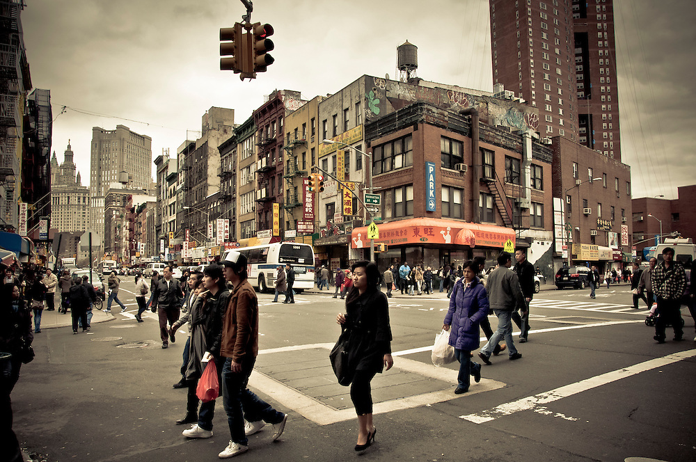 Crossing East Broadway Street in Chinatown, Manhattan, New York, 2010.