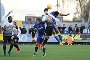 AFC Wimbledon defender Darius Charles (32) battles for possession  during the EFL Sky Bet League 1 match between AFC Wimbledon and Peterborough United at the Cherry Red Records Stadium, Kingston, England on 12 November 2017. Photo by Matthew Redman.