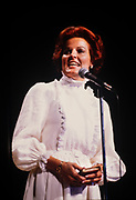 Anita Bryant holds New Testament Bible as she sings before a Christian gathering in Atlanta Georgia.