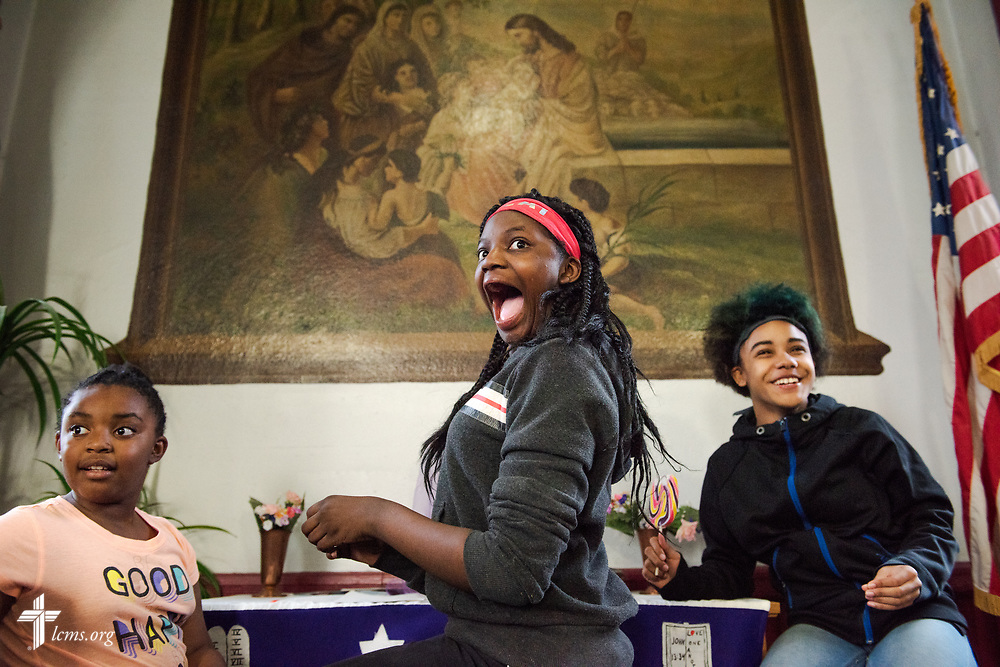 Volunteers (L-R) Darrielle Wilson, Kyiadja Nerricka, and Angelique Lennon react to winning a game of bingo at the Lutheran Outreach Center for the Blind monthly meal at St. Thomas Lutheran Church, Baltimore, on Saturday, March 24, 2018. LCMS Communications/Erik M. Lunsford