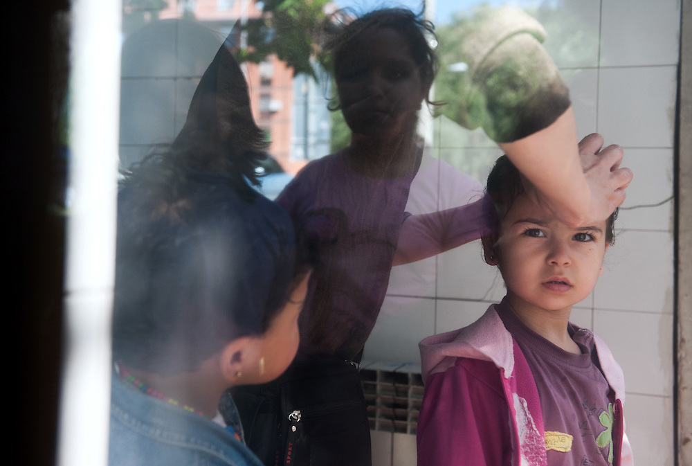 Noon, Monday 14th of September 2015. The bus from Beograd to Kanjiža stopped at the village of Bečej near the Serbian - Hungarian border. Aysha is washing the girls in the sink of the public toilet. There is a big queue as everyone wants to use the toilets after the long journey.