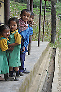 Young children in uniform on the way to school Sikkim, India