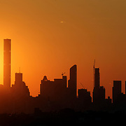 2017 U.S. Open Tennis Tournament - DAY ELEVEN. Prt of the Manhattan skyline at sunset at sunset shot from the Arthur Ashe Tennis Stadium, Queens New York, during the US Open Tennis Tournament at the USTA Billie Jean King National Tennis Center on September 07, 2017 in Flushing, Queens, New York City.  (Photo by Tim Clayton/Corbis via Getty Images)