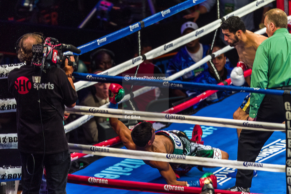 CARSON, California/USA (Saturday, Aug 24 2013) -  Abner Mares hits the canvas for the last time and stares at the main refeere after Mexican pro boxer Jhonny Gonzalez (55-8, 47 KOs) claimed the WBC Featherweight belt by TKO in the first round during his fight with Abner Mares (27-1-1, 14 KO's) at the StubHub Center (formerly Home Depot Center) in Carson, California USA. Jhonny (blue trunks) sent Abner Mares (black trunks) twice to the canvas in the first round. The main referee stopped the bout after the second knockdown at 2 minutes 55 seconds into the first  round. This is Abner first loss in his pro boxing career. August 24, 2013 in Carson, California. PHOTO © Eduardo E. Silva/SILVEXPHOTO.COM.