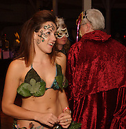 Stephanie of Centerville as Eve is on hand to tempt... er... welcome guests during Masquerage 2010 in the Roundhouse at the Montgomery County Fairgrounds in Dayton, Saturday, October 16, 2010...