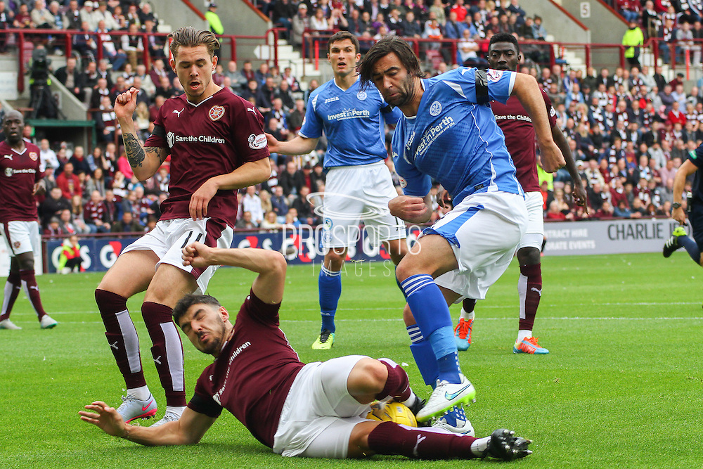 Callum Paterson put in s superb tackle on Simon Lappin during the Ladbrokes Scottish Premiership match between Heart of Midlothian and St Johnstone at Tynecastle Stadium, Gorgie, Scotland on 2 August 2015. Photo by Craig McAllister.