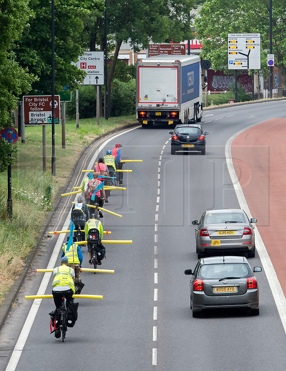 """© Licensed to London News Pictures; 03/06/2020; Bristol, UK. Protest group """"Space to Breathe"""" cycle on Newfoundland Road, the main road out of central Bristol which later becomes the M32. The campaign say there is not enough space on Bristol's pavements, cycle lanes and shared paths to take exercise while maintaining social distancing during the Covid-19 coronavirus pandemic, and they aim to show how one lane of Newfoundland road could be used for socially distanced active travel as a cycle lane. The group want pop-up cycle lanes along all of Bristol's arterial roads and more space on Bristol's roads, pavements, cycle lanes and shared paths for active travel and for taking exercise while maintaining social distancing. The cyclists ride with 2m foam tubes attached to their bicycles to highlight the space they need to safely commute and exercise with social distancing, and to encourage vehicles overtaking to pass at a safe distance. The group say that while there is less traffic on the roads, there's plenty of space to make separate lanes for walking, running and cycling and that failure to implement safe space now would be like failure to act on providing PPE. The group say that Bristol City Council's current plans for making more room will be too little too late and that other cities have already implemented more road space for cyclists and pedestrians. Photo credit: Simon Chapman/LNP."""