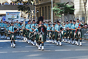 Scottish pipe band marches during Brisbane ANZAC day 2014 parade