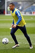 Queens Park Rangers midfielder Tjaronn Chery (8) warms up before kick off during the Sky Bet Championship match between Queens Park Rangers and Charlton Athletic at the Loftus Road Stadium, London, England on 9 April 2016. Photo by Andy Walter.