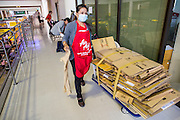 01 OCTOBER 2012 - BANGKOK, THAILAND:  An Air Asia worker finishes clean up in Don Mueang International Airport during the grand reopening Monday. Don Mueang International Airport is the smaller of two international airports serving Bangkok, Thailand. Suvarnabhumi Airport, opened in 2006 is the main one. Don Mueang was officially opened as a Royal Thai Air Force base on 27 March 1914 and commercial flights began in 1924. Don Mueang Airport closed in 2006 following the opening of Bangkok's new Suvarnabhumi Airport, and reopened as a domestic terminal for low cost airlines after renovation on 24 March 2007. Closed during the flooding in 2011, Don Mueang was again renovated and reopened in 2012 as the airport for low cost airlines serving both domestic and international passengers. On Monday, Air Asia, Asia's leading low cost airline, transferred all of their flight operations to Don Mueang and the airport was officially reopened. Suvarnabhumi International Airport is already over capacity and Don Mueang's importance as a hub is expected to grow.   PHOTO BY JACK KURTZ