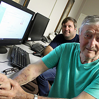 Pat Patterson, who was Monroe County sheriff for 16 years, poses with his son, Linzy, who teaches adult basic education through Itawamba Community College in a classroom at the Monroe County Government Complex. Pat completed his high school equivalency exam last week.