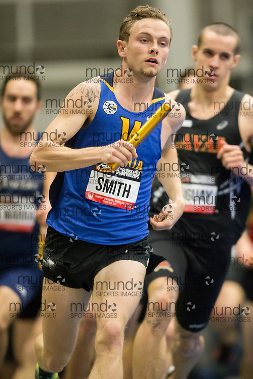 Windsor, Ontario ---2015-03-13--- Tyler Smith of the University of Victoria competes in the 4X800m at the 2015 CIS Track and Field Championships in Windsor, Ontario, March 13, 2015.<br /> GEOFF ROBINS/ Mundo Sport Images