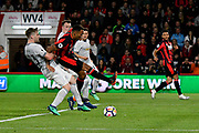 Callum Wilson (13) of AFC Bournemouth goes down in the penalty area after being challenged by Luke Shaw (23) of Manchester United which was not given as a penalty during the Premier League match between Bournemouth and Manchester United at the Vitality Stadium, Bournemouth, England on 18 April 2018. Picture by Graham Hunt.