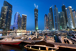 View of new Dubai Marina with yachts and high rise apartment towers to rear in Dubai United Arab Emirates , UAE