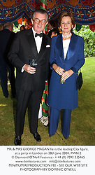 MR & MRS GEORGE MAGAN he is the leading City figure, at a party in London on 28th June 2004.PWN 2