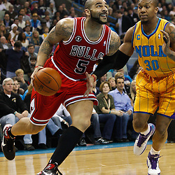 February 12, 2011; New Orleans, LA, USA; Chicago Bulls power forward Carlos Boozer (5) drives past New Orleans Hornets power forward David West (30) during the first quarter at the New Orleans Arena.   Mandatory Credit: Derick E. Hingle