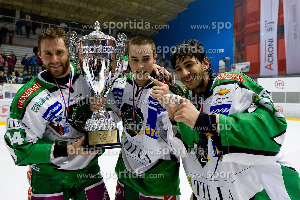 Matej Hocevar (HDD Tilia Olimpija, #14), Eric Pance (HDD Tilia Olimpija, #30) and Matija Pintaric (HDD Tilia Olimpija, #69) with trophy after ice-hockey match between HK Acroni Jesenice and HDD Tilia Olimpija in fourth game of Final at Slovenian National League, on April 2, 2012 at Dvorana Podmezaklja, Jesenice, Slovenia. HDD Tilia Olimpija won 5:2 and become national champions in season 2011/12. (Photo By Matic Klansek Velej / Sportida.com)