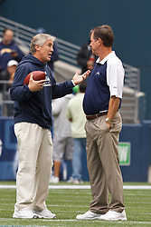 September 26, 2010; Seattle, WA, USA;  Seattle Seahawks head coach Pete Carroll (left) and San Diego Chargers head coach Norv Turner (right) talk before the game at Qwest Field. Seattle defeated San Diego 27-20.