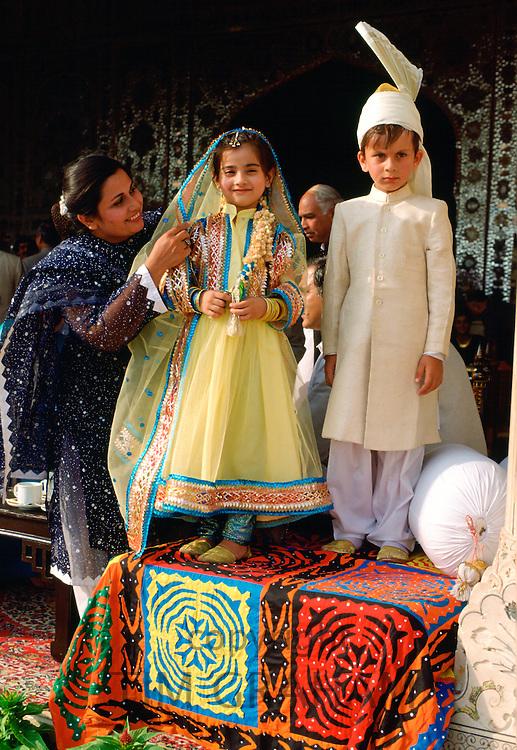 Children dressed as bride and groom in Pakistan