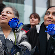 The funeral of former Prime Minister Margaret Thatcher who died Monday April 8. Two Asian mourners wait for the funeral procession to begin holding blue roses, the color of the Conservative party.