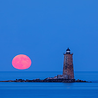 Whaleback Lighthouse with buck full moon in southern Maine near the New Hampshire border. This historic New England lighthouse is located near Portsmouth, NH and is also known as Whaleback Light or Whaleback Ledge Lighthouse. A rising full moon always attracts a lot of nature lovers and photographers alike and there was no difference last night. Originally, I was inspired by the tall and old lighthouse structure out in the ocean that tells the story of bracing Mother Nature for a century and more. After setting up tripod and camera I patiently waited for the moonrise and when it finally arrived I photographed away to ensure I captured my vision of this unforgettable natural phenomenal.   <br />
