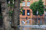 Collapsed street lighting after a burst water main closed the otherwise busy junction of Half Moon Lane and Dulwich Road in the south London area of Herne Hill. At about 5am, emergency crews were called when water inundated local homes and businesses, forcing residents to evacuate their properties and leave before electricity supplies were shut down.