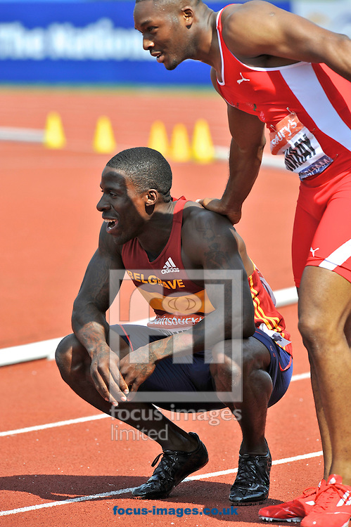 Picture by Alan Stanford/Focus Images Ltd +44 7915 056117<br /> 12/07/2013<br /> Dwain Chambers (GBR) is congratulated by Josh Swaray (GBR) after winning the 100m final during day two of Sainsbury's British Championship at Alexander Stadium, Birmingham.