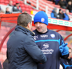 Chesterfield Manager, Paul Cook is welcomed by Swindon Town Manager, Mark Cooper prior to the Sky Bet League One match between Swindon Town and Chesterfield at The County Ground on January 17, 2015 in Swindon, England. - Photo mandatory by-line: Paul Knight/JMP - Mobile: 07966 386802 - 17/01/2015 - SPORT - Football - Swindon - The County Ground - Swindon Town v Chesterfield - Sky Bet League One